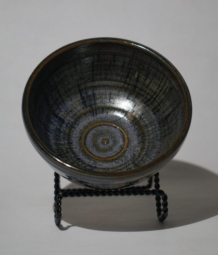 Small bowl with blue, purple, and brown glaze accents.