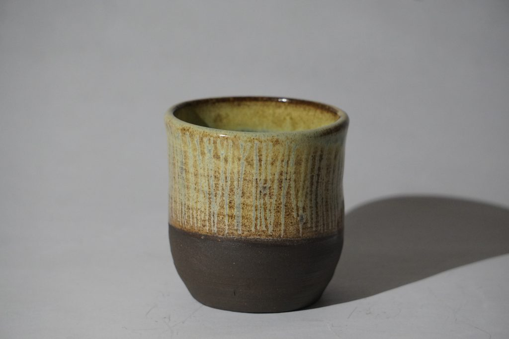 Small cup, yellow-green glaze.