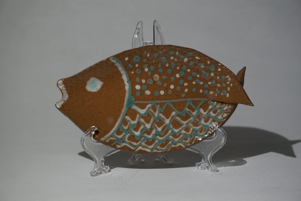 Teal and white fish dish.