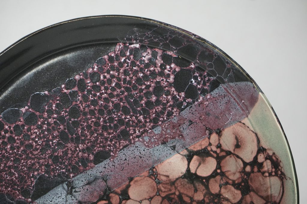"Teal, black, and purple bubble glaze 10"" plate."
