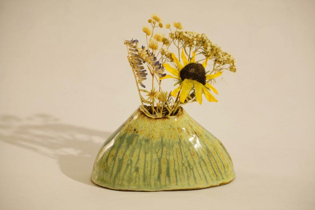 Mountain shaped small bud vase.