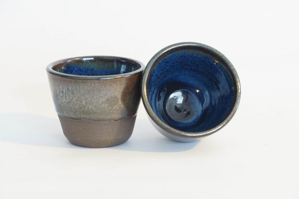 Small metallic brown and blue cups.