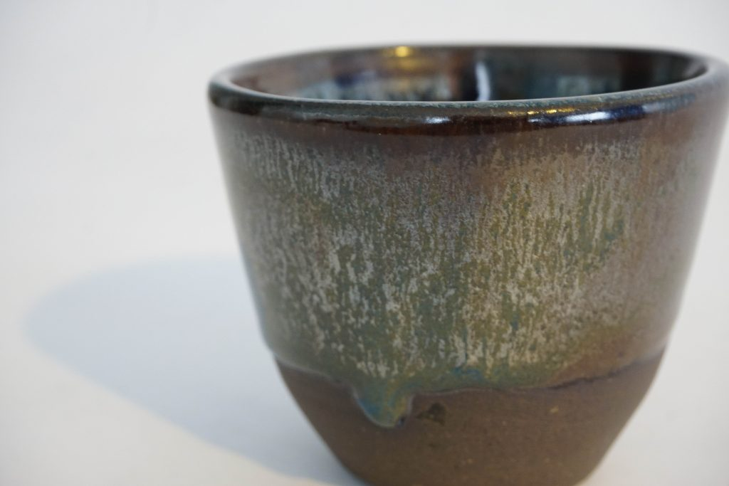 Small metallic brown and blue cup. (Outside)